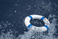 Lifebuoy safety equipment on waves in sea storm Royalty Free Stock Photography