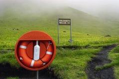 Lifebuoy Safety on green landscape. Iceland. Iceland Cave Path, Hallsaner Hellir. Lifebuoy Safety Royalty Free Stock Image
