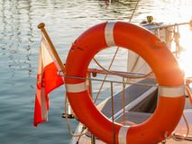 Lifebuoy on sailboat and polish ensign Royalty Free Stock Photo