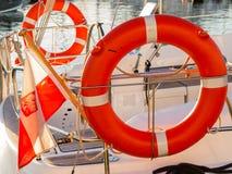 Lifebuoy on sailboat and polish ensign Stock Photography