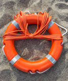 Lifebuoy on sand Royalty Free Stock Image