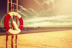 Lifebuoy on Sandy Beach Royalty Free Stock Images