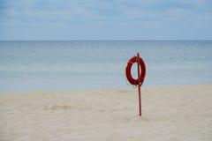 Lifebuoy on a sea background. Beach season Stock Photography