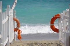 Lifebuoy at a beach Stock Photos