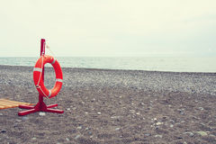 Lifebuoy on a sea beach Stock Photos