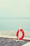 Lifebuoy on the sea beach Stock Images