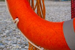 Lifebuoy on a sea beach. Orange lifebuoy on a pebbly sea beach, sunset Royalty Free Stock Photography