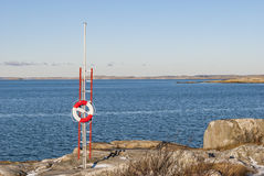 Lifebuoy by the sea in winter. Nature Royalty Free Stock Photo