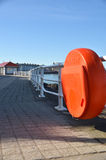 Lifebuoy on  seaside walkway Royalty Free Stock Image