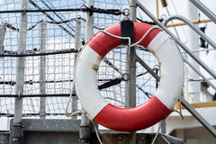 Lifebuoy on a ship. Lifebuoy attached to the railing on a ship royalty free stock photography