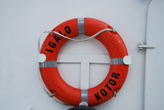 A lifebuoy on a ship in Montenegro. A lifebuoy on a ferry with the name  Igalo in Kotor, Montenegro Royalty Free Stock Images