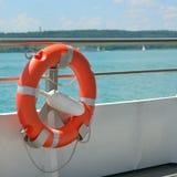 Lifebuoy on a ship. Orange lifebuoy on a ship Stock Images