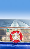 Lifebuoy on a ship at sea. Stock Photo