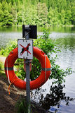 Lifebuoy on the shore. Of a forest lake. help and rescue people in the water Royalty Free Stock Photography