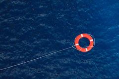 Lifebuoy in a stormy blue sea, safety equipment in boat. Royalty Free Stock Images
