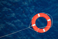 Lifebuoy in a stormy blue sea, safety equipment in boat. Stock Photo