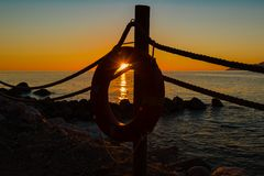 Lifebuoy and sundown Stock Photography