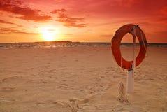 Lifebuoy and sunset Stock Photo