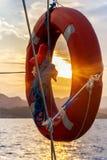 Lifebuoy at sunset. Stock Images