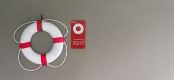 Lifebuoy or Swim Tube on Wall at Swimming Pool for Safety stock images