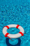 Lifebuoy in a swimming pool Stock Photo