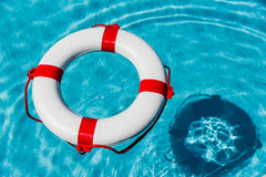 Lifebuoy in a swimming pool Stock Photos