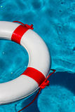 Lifebuoy in a swimming pool Royalty Free Stock Photos