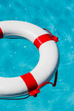 Lifebuoy in a swimming pool Royalty Free Stock Images