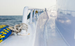 Lifebuoy tethered to the railing of the deck of yacht Stock Photography