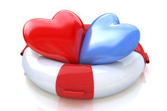 Lifebuoy and two hearts Royalty Free Stock Image