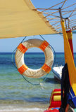 Lifebuoy. Under a white awning on a background of blue sea Stock Images