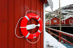 The lifebuoy on the wall of a house Stock Image