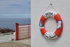 Lifebuoy on wall stock photography