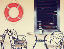 Lifebuoy on the wall of outdoor cafe Royalty Free Stock Photo