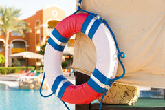 Lifebuoy on the wall. Pool background. Security at the hotel Royalty Free Stock Images