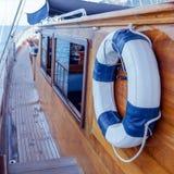 Lifebuoy on the wall of sailboat . Stock Photography
