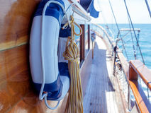 Lifebuoy on the wall of sailboat . Royalty Free Stock Photography