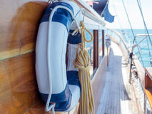 Lifebuoy on the wall of sailboat Stock Images