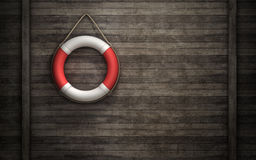 Lifebuoy on wall Royalty Free Stock Image