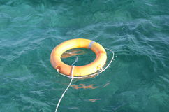 Lifebuoy on the water. Orange Lifebuoy on the sea water waves Royalty Free Stock Image