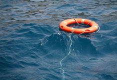 Lifebuoy on the water. Lifebuoy on  surface of the ocean Royalty Free Stock Images