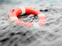 Lifebuoy on water surface Royalty Free Stock Images