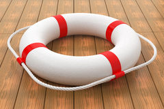 Lifebuoy on wood floor. Stock Images