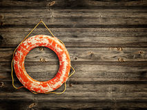 Lifebuoy at wooden background Royalty Free Stock Photography