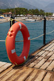 Lifebuoy on wooden pier Stock Photography