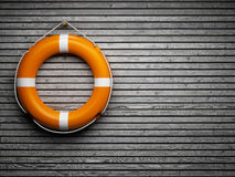 Lifebuoy on wooden wall Royalty Free Stock Photos