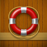 Lifebuoy on a wooden wall. Stock Image