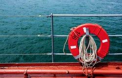 Lifebuoy y mar Imagen de archivo libre de regalías