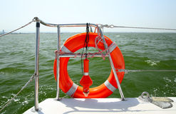 Lifebuoy on a yacht side. Royalty Free Stock Photo
