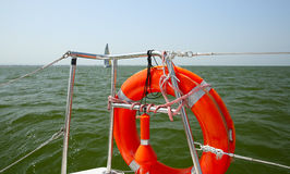 Lifebuoy on a yacht side. Concept of safe sea walk. Stock Image
